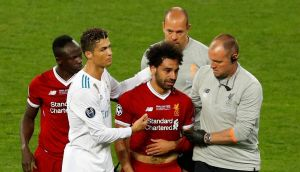 Liverpool's Mohamed Salah with Sadio Mane and Real Madrid's Cristiano Ronaldo as he is substituted after sustaining an injury. Photograph: Phil Noble/Reuters