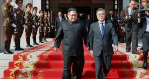 North Korean leader Kim Jong Un and South Korean president Moon Jae-in walk after their meeting at the northern side of Panmunjom in North Korea. Photograph: South Korea Presidential Blue House/AP