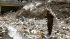 A woman stands on rubble of damaged buildings in Raqqa, Syria. File photograph: Reuters.