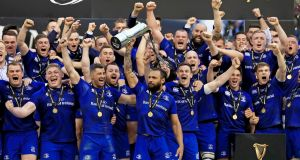 Leinster captain Isa Nacewa and his team-mates celebrate after winning the Pro14 final against Scarlets at the Aviva Stadium, Dublin, on Saturday. Photograph: PA