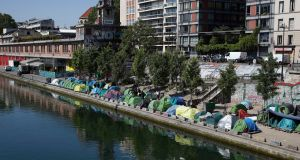 Tents where migrants live in a makeshift camp are packed alongside of the canal Saint-Martin in Paris on  May 18th. Photograph: Francois Mori/AP