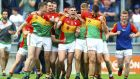 Carlow players celebrate at the final whistle after their Leinster SFC quarter-final victory over Kildare at  Bord na Mona O'Connor Park in  Tullamore. Photograph: Ken Sutton/Inpho