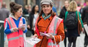 A campaigner with the Love Both anti-abortion campaign canvasses members of the public on Thursday, a day ahead of the referendum on the Eighth Amendment. Photograph: Barry Cronin/AFP/Getty Images