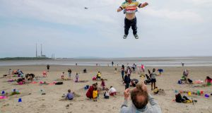 One-year-old Benji Duckenfield takes flight as his dad Mark waits for touchdown on Sandymount Strand. Photograph: Marc O'Sullivan
