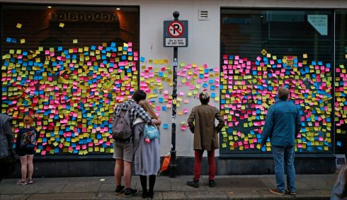 'Post It' labels adorning the exterior of the Temple Bar Gallery, each 'Post It' carrying it's own message of support for the 'YES' Campaign.  Photograph Nick Bradshaw