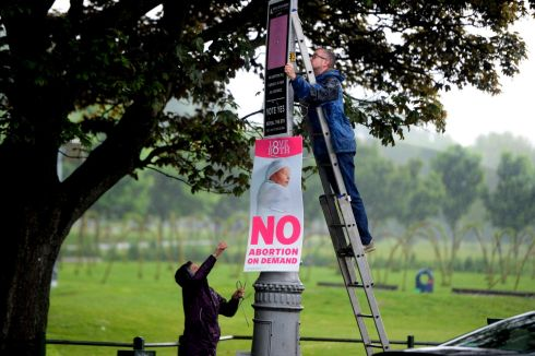 Referendum posters being removed in Fairview. Photograph:  Cyril Byrne / The Irish Times