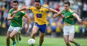 Roscommon's John McManus with Paddy Maguire and Ryan O Rourke of Leitrim during the Connacht semi-final at Carrick-on-Shannon. Photograph: Tommy Grealy/Inpho