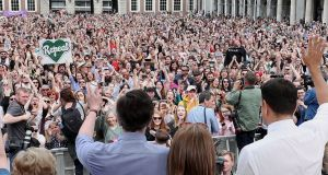 Minister for Health Simon Harris and Taoiseach Leo Varadkar wave at crowds in Dublin Castle. Photograph: Niall Carson/PA Wire