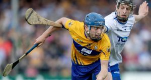 Clare's Shane O'Donnell and Barry Coughlan of Waterford compete for the ball. Photograph: Laszlo Geczo/Inpho