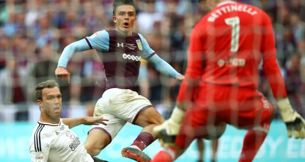 d43f216bfa9 Jack Grealish of Aston Villa watches on as Marcus Bettinelli of Fulham  saves his shot during