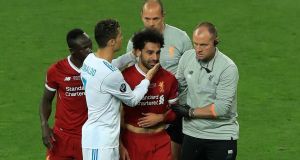 Real Madrid's Cristiano Ronaldo consoles Liverpool's Mohamed Salah as he leaves th pitch injured during the  Champions League final at the NSK Olimpiyskiy Stadium, Kiev. Photograph: Peter Byrne/PA