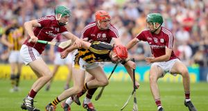 Galway's Cathal Mannion, Conor Whelan and Brian Concannon around James Maher of Kilkenny during  the Leinster hurling championship match at Pearse Stadium, Galway. Photograph: Oisin Keniry/Inpho