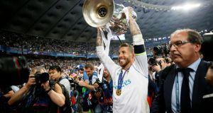 Sergio Ramos celebrates with the trophy after Real Madrid retained  the Champions League with victory over Liverpool in the Olympic Stadium in Kiev. Photograph: Gleb Garanich/Reuters