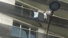 Paris 'hero' scales four storeys to rescue child in viral footage