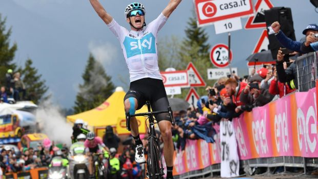 Froome celebrates as he crosses the finish line to win the 14th stage. Photo: Daniel Dal Zennaro/EPA