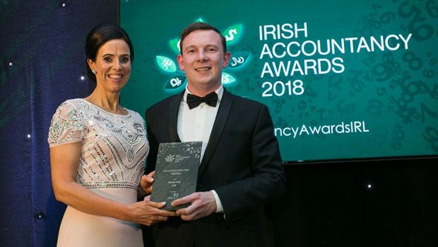 Tom O'Reilly, Head of Partnerships, Linked Finance presents the Accountant of the Year - Industry award to Monica Kelly, CDE Global