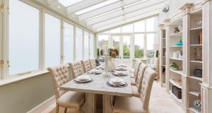The kitchen opens at the end into a bright conservatory – described as an orangery – which operates as the diningroom