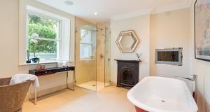The substantial basement space includes  a large smart family bathroom with shower and freestanding clawfoot bath