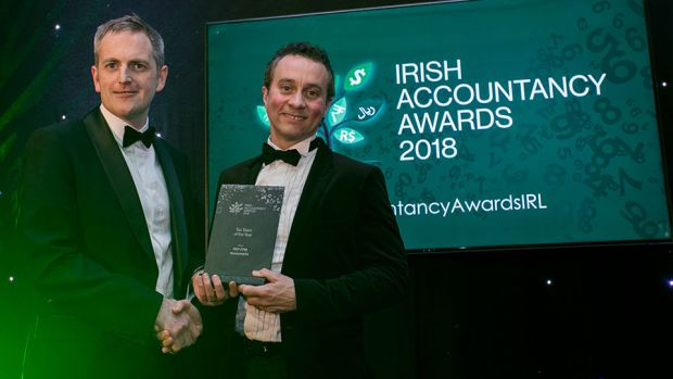 Gary Cullen, Head of Client Management, Harvest Financial Services presents the Tax Team of the Year award to Malachy McLernon, PKF-FPM Accountants.
