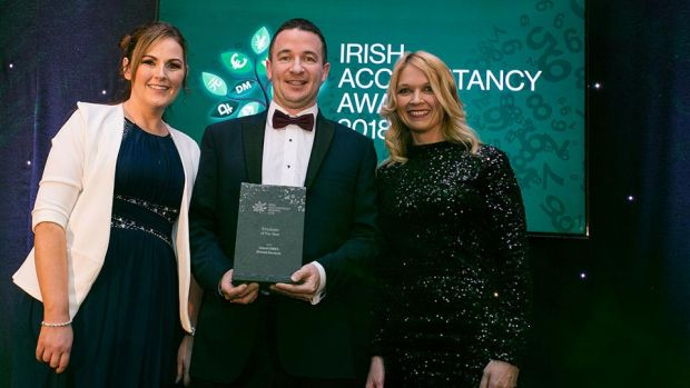 James Gallagher, Associate Director, Accounting Finance and Tax, Morgan McKinley presents the Employer of the Year award to Jennifer Dalton and Grace Winters, Abbott EMEA Shared Services