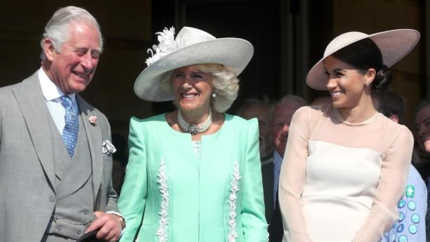 Right royal knees-up: Prince Charles, his wife, Camilla, and their new daughter-in-law, who has married into one of the most conservative, classist and wealthy families on the planet. Photograph: Chris Jackson/Getty