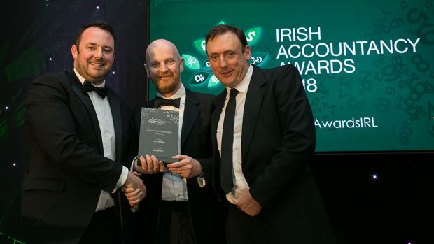 Micheal O'Neill, CEO, OmniPro presents the Excellence in Education & Training award to Philip Burke and Owen O'Reilly, City Colleges