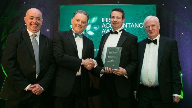 Tony Connolly, CEO, AccountsIQ presents the Best Use of Technology in Accountancy & Finance award to Brendan Killcoch, Jason Dowling and Sean Whelan, Whelan Dowling & Associates