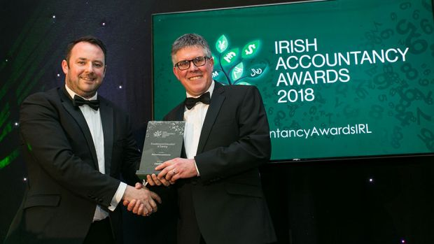 Micheal O'Neill, CEO, OmniPro presents the Excellence in Education & Training award to Dave O'Donoghue, Accountancyschool.ie