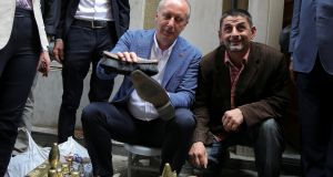 Muharrem Ince, Turkey's main opposition Republican People's Party's (CHP) candidate in the June 24th presidential  election, with a shoeshiner in Istanbul. Photograph: Huseyin Aldemir