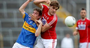 Tipperary's Bill Maher with Ian Maguire of Cork in the Munster SFC semi-final at Semple Stadium, Thurles, last Saturday. Photograph: Oisin Keniry/Inpho