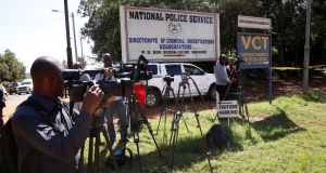 Journalists wait outside the Director of Criminal Investigation headquarters, following the arrest of the head of the National Youth Service, Richard Ndubai, along with an unspecified number of officials over corruption in Nairobi, Kenya, on Monday. Photograph:  Baz Ratner/Reuters