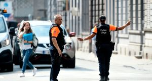 Police officers redirect traffic in the eastern Belgian city of Liege after an armed man killed two police officers. Photograph: AFP/Getty Images