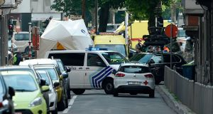 Police and ambulance are seen at the site where an armed man shot and killed police officers in the eastern Belgian city of Liege. Photograph: AFP/Getty Images