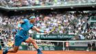 Spain's Rafael Nadal plays a backhand return to Italy's Simone Bolelli during their men's singles first round match on day three of the Roland Garros 2018 French Open in Paris. Photo: Christophe Simon/Getty Images