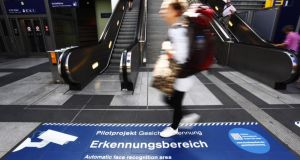 A security sign in a Berlin train station warns passers-by about an automatic face-recognition system. Photograph: Michele Tantussi/Getty Images