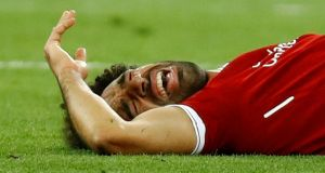 Liverpool's Mohamed Salah reacts after sustaining an injury in the Champions League final. Photograph: Reuters