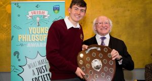 Irish Yong Philosopher Award winner Luke Rickard (16) with President Michael D. Higgins. Photograph: UCD Colleges of Social Sciences and Law