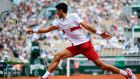 Novak Djokovic plays a backhand return to Spain's Jaume Munar during their men's singles second-round match at the French Open. Photograph: Christophe Simon/AFP/Getty Images