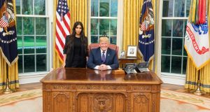 President Donald Trump with Kim Kardashian at the Oval Office in the White House. Photograph: Twitter