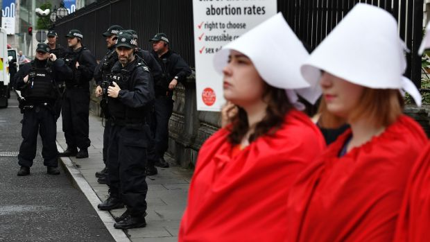 PSNI officers watch on as abortion rights campaign group Rosa hold a protest on Thursday in Belfast. Photograph: Charles McQuillan/Getty Images
