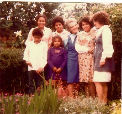 Kit de Waal (back row left) with her siblings, mother Sheila O'Loughlin (far right) and grandmother in her back garden in Erasmus Road, Sparkbrook, a stone's throw from the Irish Community Centre in Digbeth, which features in The Trick to Time