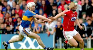 Tipperary's Mickey Cahill in action against Cork's Shane Kingston during the Munster championship clash at Thurles.  Photograph: James Crombie/Inpho