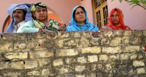 Residents of Nanga village in India   in a building damaged by alleged shelling from the Pakistani side of the  Kashmir border on May 23th. Photograph:  EPA/Jaipal Singh