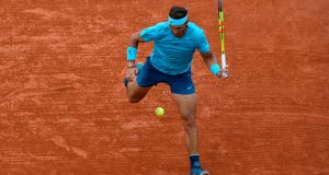 Spain's Rafael Nadal plays a return between his legs to Argentina's Guido Pella during their men's singles second round match on day five of the Roland Garros 2018 French Open. Photo: Eric Feferberg/Getty Images