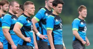 Joey Carbery (second right) with Jack McGrath and  Andrew Conway at an Ireland squad session at Carton House yesterday. Photograph: Billy Stickland/Inpho