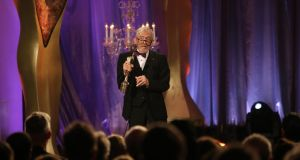 Shay Healy  receives a lifetime achievement award on stage at the IFTA Gala Television Awards in the RDS. Photograph: Kyran O'Brien