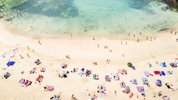 Aerial view of people at Papagayo beach in Lanzarote