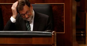 Ousted Spanish prime minister Mariano Rajoy gestures during a parliamentary session in Madrid, Spain.