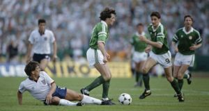 Euro 88: Ray Houghton moves past Kenny Sansom on his way to scoring against England. Photograph: Bob Thomas/Getty Euro 88: Ray Houghton moves past Kenny Sansom on his way to scoring against England. Photograph: Bob Thomas/Getty