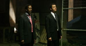 Clarke Peters and Dominic West in a scene from season five of The Wire